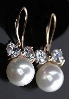 Elegant pair of bowknot shaped rhinestone and pearl earrings.