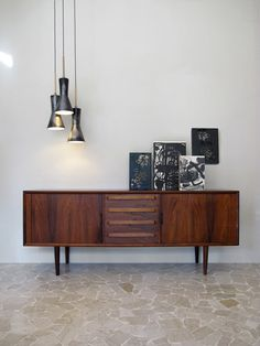 Modernist interior design - 60s modern danish rosewood Sideboard - Italian ceramic ceiling lamps - www.capperidicasa.com