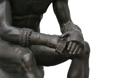 Modern copy of the Boxer of Quirinal, a Greek bronze statue from the 1st Century B.C.. Cestus gloves were commonly used in Pankration. Pankration, introduced into the Greek Olympic Games in 648 BC, was a combat sport that consisted of a mixture of boxing and wrestling, but with scarcely any rules.