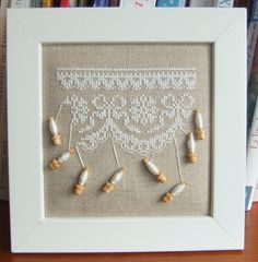 I would love to try this one day - cross stitch with real bobbins.