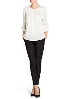 Satin-finish pleated blouse and Cropped slim trousers.