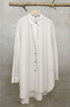 thatordinaryguy:  Ann Demeulemeester long blouse with half-concealed button front