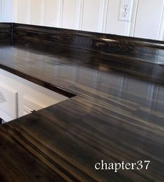 Morning by Morning Productions: DIY Kitchen Countertops using pine, black stain and polyurethane -- Pretty wood countertop. Thinking about what a wood countertop would look like in the new kitchen, just for the island. Diy Wood Counters, Kitchen Countertops, Plywood Countertop, Kitchen Cabinets, Staining Plywood, Pallet Countertop, Concrete Countertops, Kitchen Island, Kitchen Redo