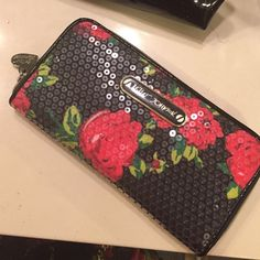 Betsey Johnson Sequined Wallet Like new condition. Betsey Johnson sequined flowers wallet. This wallet pops. I also have the matching purse in my closet. Super cute.... Trade value $45 Betsey Johnson Bags Wallets