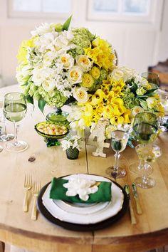 yellow wedding centerpiece for wedding  http://www.bridalguide.com/blogs/the-budget-guru/questions-to-ask-a-florist