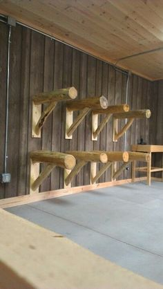 Saddle racks for the foyer/entry to display our special saddles. Will look great in our log home. horse ranch life