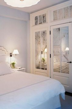 You don't want to overdo it with mirrors in the bedroom. Mirrored door panels show just enough of your room.