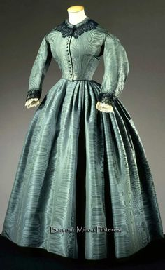 Afternoon dress ca. 1860. Green silk moiré taffeta with black lace and ivory ribbon. Two pieces. Galleria del Costume di Palazzo Pitti via Europeana Fashion