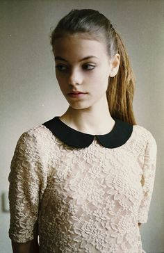 White lace and black peter pan collar