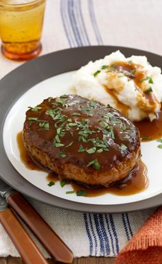 Salisbury Steak with Mashed Potatoes & Gravy -- Got a taste for a good meat and potatoes dish? Here's a great Salisbury Steak recipe--gravy included!