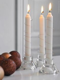Candles decorated with copper wire