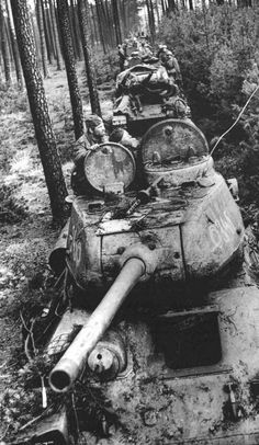 T34/85 tanks moving through a forest road. 1944-45