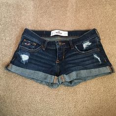 Jean Shorts Jeans shorts with a few decorative rips on the front, fading, and embroidered back pockets. Hollister Shorts Jean Shorts