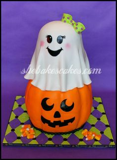 cute ghost and pumpkin cake