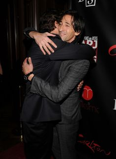 """Adrien Brody Photos - (Exclusive Coverage) Actors Gerard Butler (L) and Adrien Brody attend the Artists for Peace and Justice's """"Let's Build a School for Haiti"""" fundraising dinner at Salon Millesime at the Carlton Hotel on November 5, 2010 in New York City. - Artists For Peace And Justice's """"Let's Build A School For Haiti"""" Fundraising Dinner - Arrivals"""