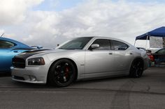 DODGE CHARGER SRT BLACK CHROME rims with red calipers. It's a fight between these and the Dodge Viper Rims.