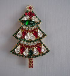 """BEE GEE Christmas tree brooch with red, clear and green rhinestones set in gold tone, 3-1/8"""".  Z"""