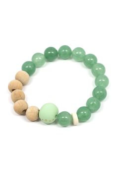 These bracelet is made with hand formed polymer and wood beads, and would look great stacked against other  Ecru designs!