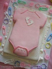 Blanket and Onesie Baby Shower Cake | by Sweet Icing Bakeshop