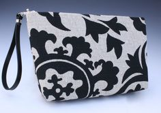Add Libb Design clutch design, small.  Black and white, how could you go wrong!