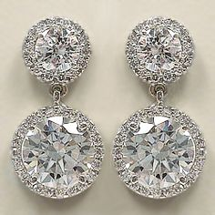 Our Skye round drop earrings feature a 0.50 carat round stone top with a 2.0 carat round shaped stone on the bottom surrounded by a halo of pave set cubic zirconia stones.  Approximately 6.0 carats total weight, these earrings measure approximately 13/16 inches (20.5 mm) from top to bottom. These earrings are available in 14K white or yellow gold.  Model: 5315R.5R2, $950.00  Mystiquegems.com Jewelry