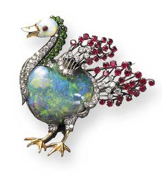 AN OPAL AND GEM-SET BIRD BROOCH, BY OSCAR HEYMAN & BROTHERS Designed with an opal body enhanced by circular-cut diamond and ruby wings and gold feet, the opal head accented by a gold beak and cabochon ruby eye, with a circular-cut diamond and demantoid garnet neck, mounted in platinum and gold.