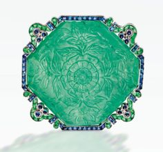 Cartier carved emerald and sapphire brooch circa 1920