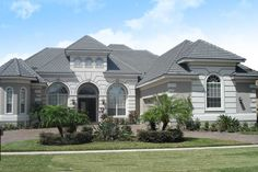 Three sweeping Palladian windows welcome you home. Stone architectural elements create a traditional Old World look. Perfectly balanced rooms and locations make this the perfect family house with a second floor that has a private balcony for the special guest.FLORIDA RESIDENTS:We can coordinate engineering for you. Contact us for pricing. Modern Residential Architecture, Architecture Artists, Florida House Plans, Florida Home, Dream Home Design, House Design, I Love House, Monster House Plans, Mediterranean Homes