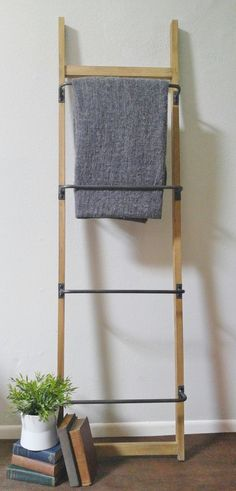 This ladder style wall rack has so many uses. You can hang blankets, towels, baskets, accessories, magazines, and even a herb garden. Lean it on a wall or att