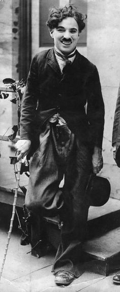 """Chaplin: """"I wanted everything to be a contradiction: the pants baggy, the coat tight, the hat small and the shoes large ... I added a small moustache, which, I reasoned, would add age without hiding my expression."""""""