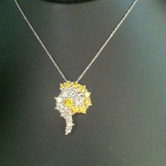 Reversible yellow and white diamond necklace