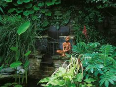 This peaceful garden corner features an array of sculptures woven into a waterfall setting.
