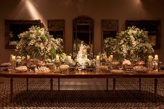 Wedding dessert table with beautiful flower arrangements and mirrors