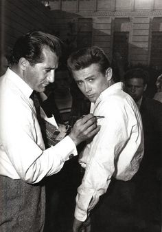 """James Dean preparing for the """"knife fight"""" scene in """"Rebel Without A Cause"""", 1955."""