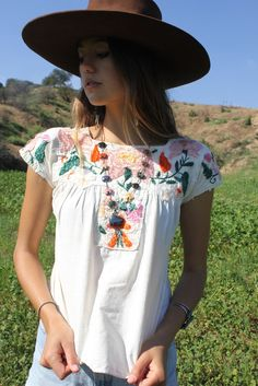 So Lovely! My Heart skips a Beat a little when I see these old Mexican blouses... Hand Embroidered Flowers with Silk Thread Natural Cotton Circa ~ 1940s Best Fits a Small Bust ~ 19 inches under arm to