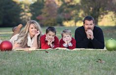 Family holiday photo idea! Get beautiful ornaments to frame the family on both ends :)