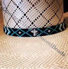 Beaded hat band in a straw American hat co beadwork by Quarter Circle  Diamond Beads. Visit Facebook.com quartercirclediamondbeads 2c2a6b66d9e