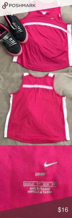 NIKE Dri-Fit Pink Running Work-Out Tank XS Hot pink running or work out tank with white mesh side panels and light pink stripe across chest and back. Keyhole cut out in the neckline. Dri-fit technology wicks moisture away from your skin for a more comfortable work out. Size XS Nike Tops Tank Tops