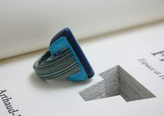 laminated paper from the book to make a ring.