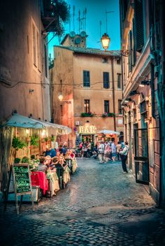 Rome, Italy   -  the streets were so quaint and certainly an experience.  We stayed in an apartment above a cafe overlooking a scene such as this.