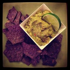Naveen's guacamole:     1 avocado  1/8 cup chopped red onion  2 sprigs cilantro  juice of one lime  1/2 teaspoon of course salt  pepper  1 clove garlic   Throw all ingredients into a Nutribullet, in the small cup.  Use pulse method until desired consistency is reached (about 5 pulses).   1 serving.