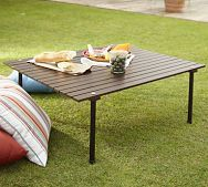 This table is amazing - the short legs screw on, and the top rolls. Perfect for a picnic in the park!!