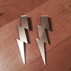 NWOT Lightning bolt earrings- clip ons- gold Never worn! Really cool acrylic lightning bolt shapes. Clip on style. Also available in pink, red, and mirrored silver. Feel free to bundle! Jewelry Earrings