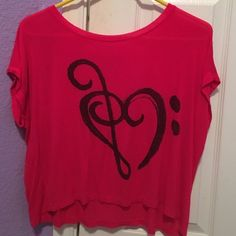 Music Shirt Super cute shirt for music lovers! Treble clef and bass clef make a heart.  Perfect over a tank top or worn as a crop top. Loose fitting with super soft material. Says size XS but could also probably fit a small or medium. Used, but in great condition!  NO TRADES. NO HOLDS. NO MERC@RI  Please make any offers through the offer button   Questions? Just ask! EVERYTHING MUST GO! Ask me about my bundle discounts!  Tops Blouses