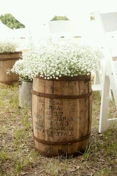 Vintage Wine Barrel Planter. This is beautiful! I like the idea of lemon grass in them because i heard it helps keep the mosquitos away which would be perfect in the back yard!