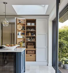 Luxury Kitchens Hidden pantry storage in our Hartford Blue Shaker Kitchen - This blue shaker kitchen has been designed with family in mind, full of state of the art appliances and hidden storage solutions. Kitchen Larder, Kitchen Island Decor, Kitchen Cupboards, Home Decor Kitchen, Kitchen Styling, Country Kitchen, Diy Kitchen, Kitchen Storage, Pantry Storage