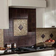 Ion Metals 4 x 4 Field TIle with 1 x 6 Rope Liner in Oil Rubbed Bronze above stove range. Backsplash features Ion Metals 4 x 4 Rope Decos in Oil Rubbed Bronze and Slate 1 x 1 Mosaic in Copper with Marron Cohiba Granite on the countertops, from Datile Cuisine Tudor, Kitchen Backsplash, Kitchen Countertops, Backsplash Ideas, Tile Ideas, Mosaic Backsplash, Granite Countertop, Kitchen And Bath, Home Decor