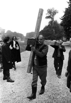 Luis Bunuel carrying the cross