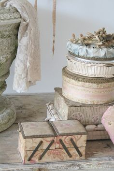 Fabric-covered boxes..  The sewing box..  Old sewing basket.
