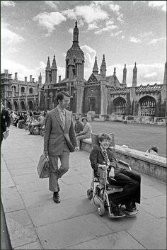Ian Berry England. Cambridge. Professor Stephen Hawking in his wheelchair in front of university buildings. 1977